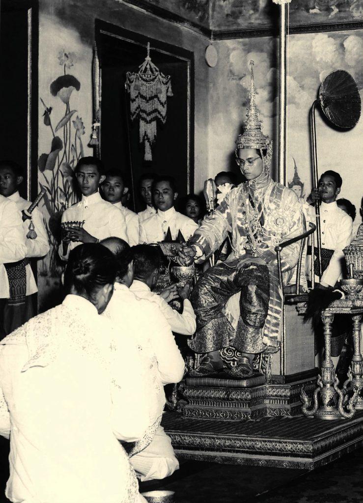 king_rama_ix_being_presented_with_regalia_at_coronation